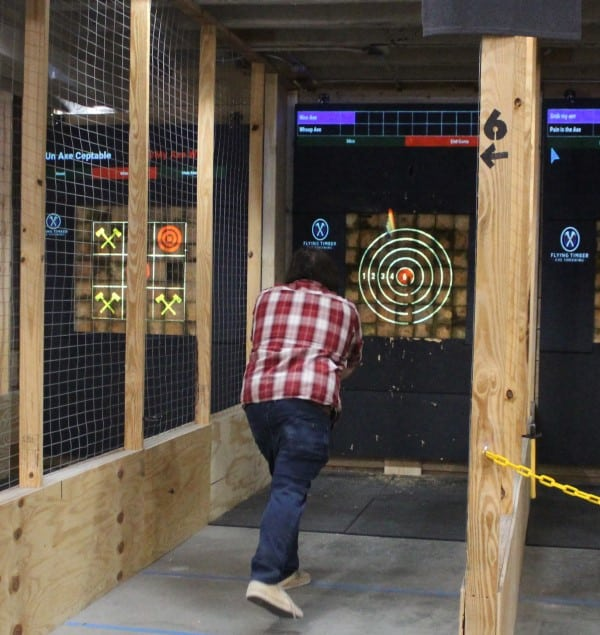 guy in front of axe throwing target