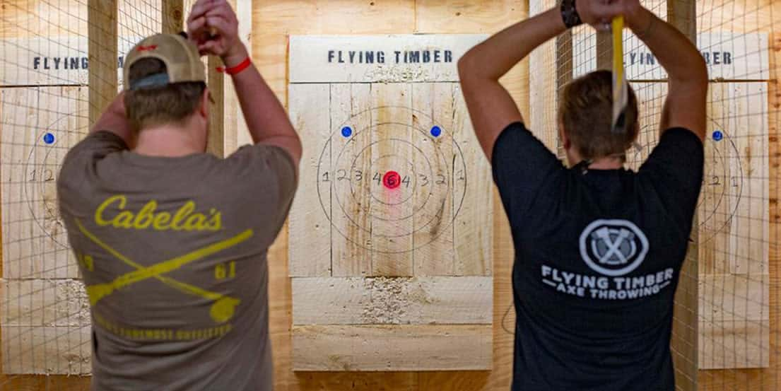 two guys throwing axes