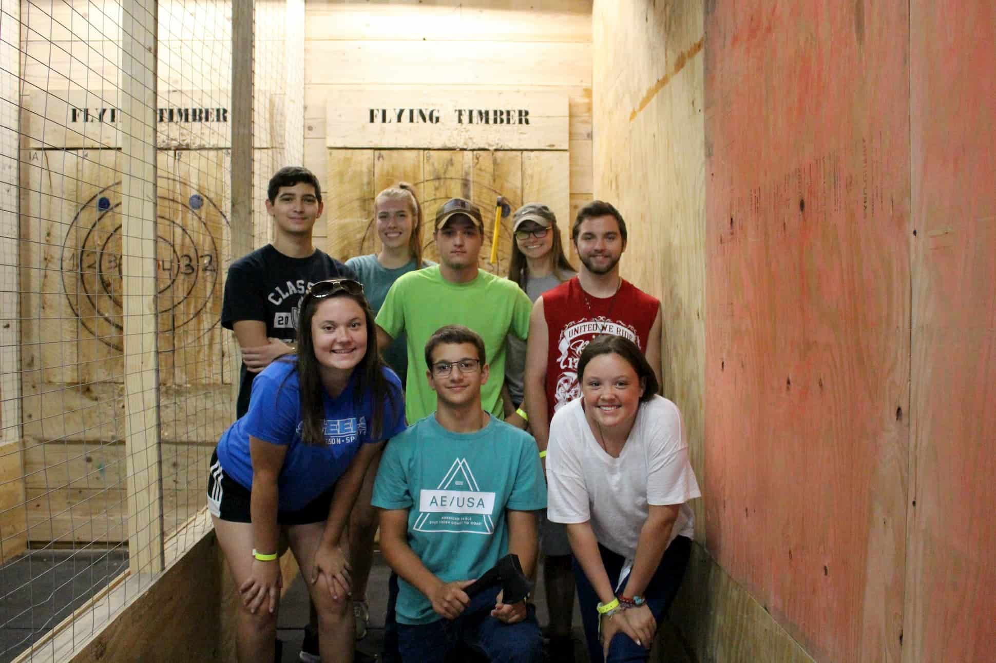 group at axe throwing birthday party